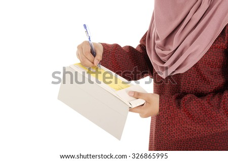 Young muslimah businesswoman signing cheque with white background. - stock photo