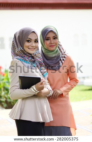 young muslimah woman in campus - stock photo