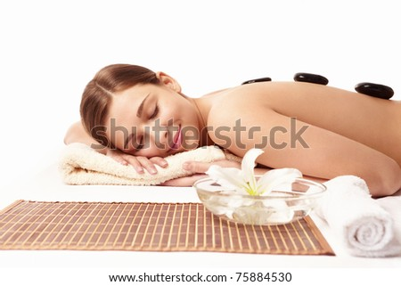 Young naked girl in a spa on a white background - stock photo
