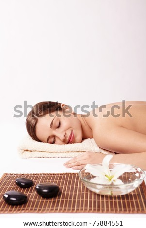 Young naked girl in a spa on a white background