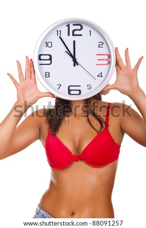 young naked woman holding clock on face on white background - stock photo
