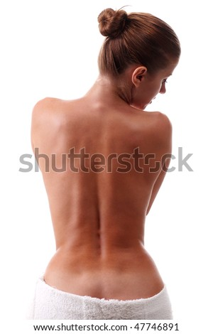young naked woman in white towel isolated at background - stock photo