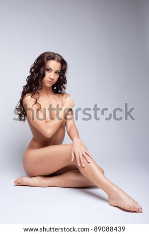 young naked woman posing for nude photography - stock photo