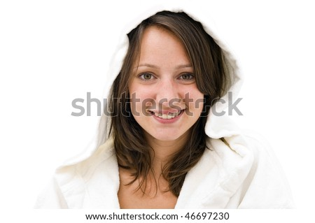 Young natural looking smiling brunette woman wearing a white bathrobe with hood on a bright background - stock photo