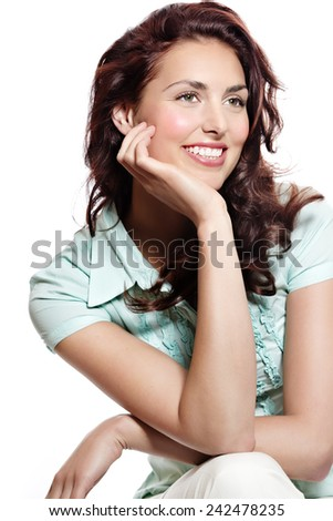 Young natural woman sitting and smiling.