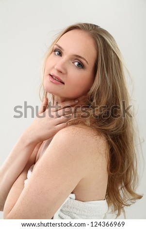 Young natural woman with clear face isolated over white background - stock photo