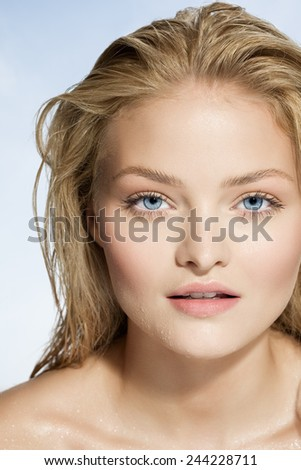 Young natural woman with wet hair and face. - stock photo