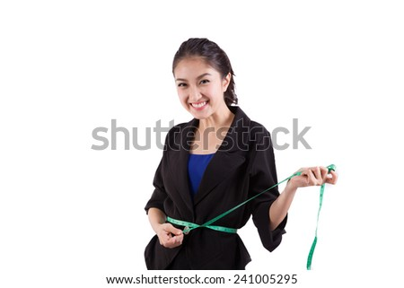 Young needlewoman taking measures of herself - stock photo