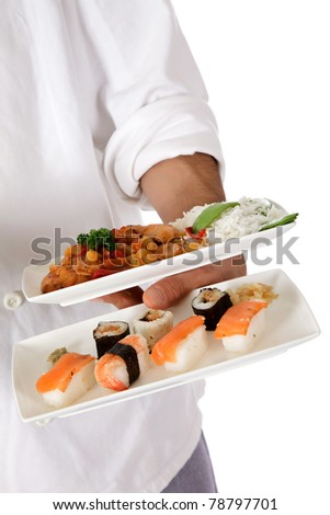 Young nepalese chef hand holding two plates with tasty oriental food. Studio shot. White background. - stock photo