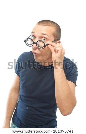 Young nerd with glasses looking at the camera and try to flirting, isolated on white - stock photo