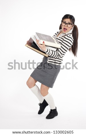 Young nerd woman holding lots of books - stock photo