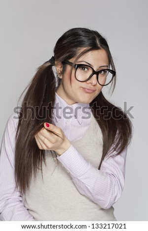 Young nerd woman posing on white background - stock photo