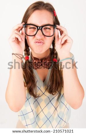 Young nerdy cute girl blowing kisses. Studio shot. - stock photo