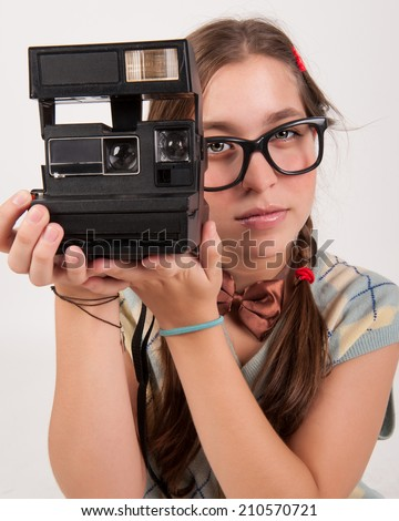 young nerdy photographer. - stock photo