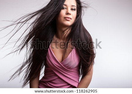 Young nice asian girl poses in studio.