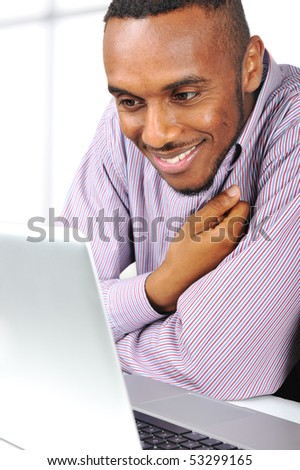 Young nice black man on laptop - stock photo