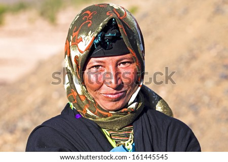 Young nomad woman in the desert - stock photo