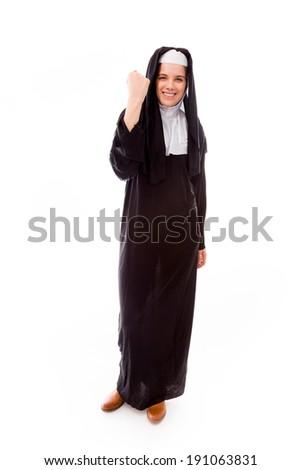 Young nun celebrating success - stock photo