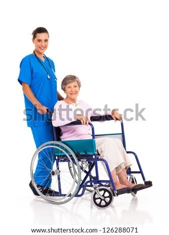 young nurse and senior patient isolated on white - stock photo