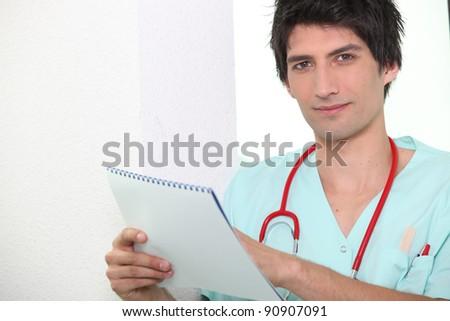 Young nurse checking calendar - stock photo