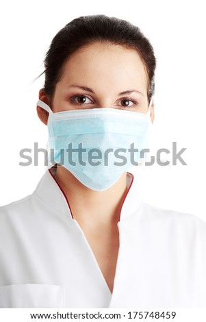 Young nurse in mask , isolated on white background - stock photo