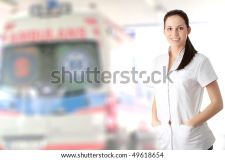 Young nurse or female doctor , with ambulance in background - stock photo