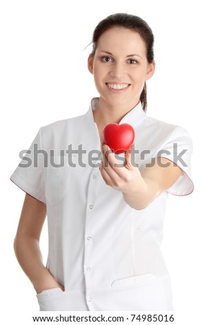 Young nurse with heart in her hand, isolated on white background - stock photo