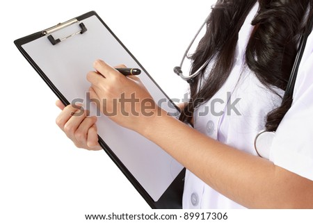 Young nurse writing medical records isolated over white background