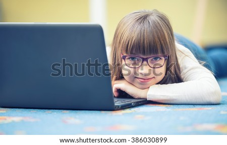 Young of beautiful pre-teen girl with tablet laptop pc. Education technology for teenagers - adolescents children. Toned image - stock photo