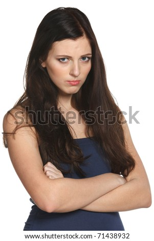 Young offended female standing with crossed hands isolated on white - stock photo