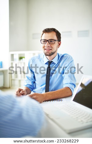 Young office worker in office of leader - stock photo