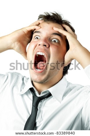 young office worker mad by stress screaming and holding head in hands isolated on white background - stock photo