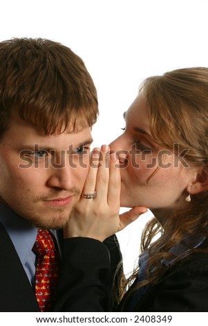 Young office workers whispering - stock photo