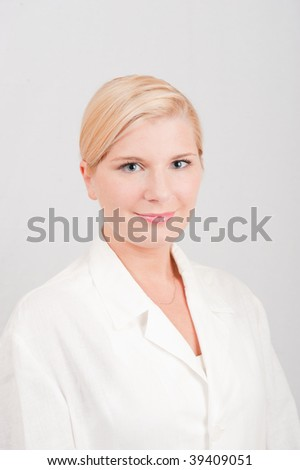 Young optimistic female doctor in an uniform - stock photo
