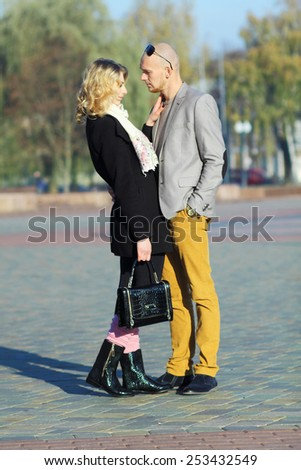 Young outdoor fashion portrait of beautiful couple kissing on the street. beautiful young couple hugging the city - stock photo