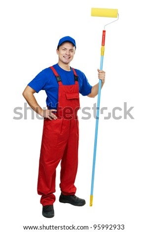 Young painter man in uniform with  paint roller Isolated over white background - stock photo