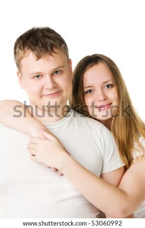 young pair in white T-shirts, the girl embraces the man, isolated on white - stock photo