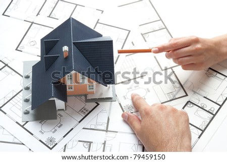 Young pair planning living together in new house (marital domicile) - stock photo