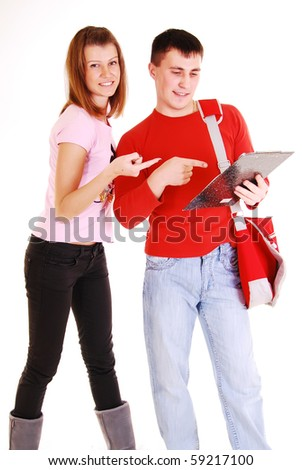 Young pair students with of books isolated on a white background.