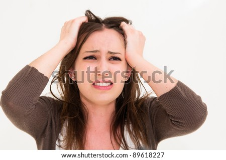 Young panic woman with hands on the head - stock photo