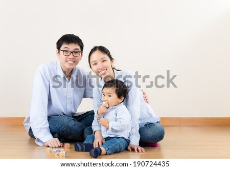 Young parent with baby son - stock photo