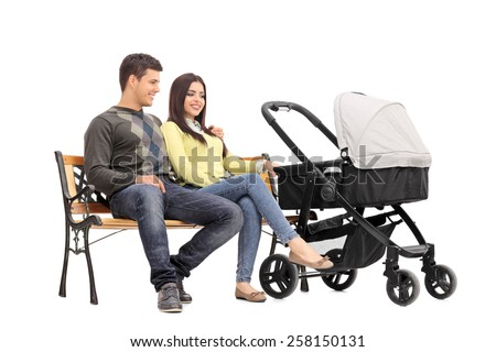 Young parents sitting on a bench with their baby isolated on white background