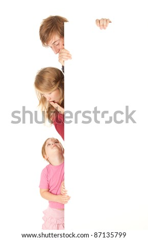young parents with beautiful daughter keeping blank sign, white background - stock photo