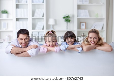Young parents with children at home