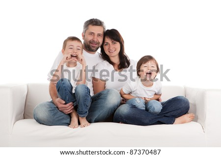 Young parents with children at home. - stock photo