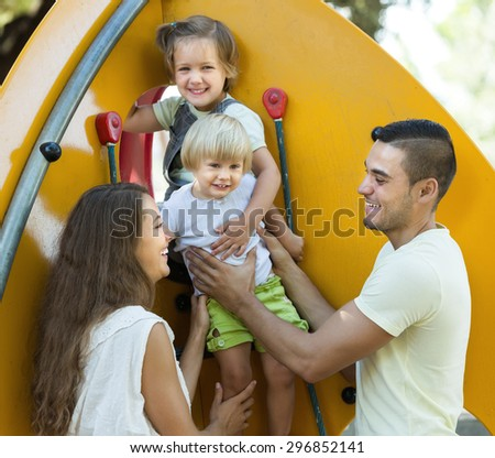 Young Parents with children at playground's  vacation day on park