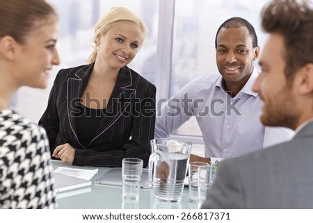Young partners having businessmeeting, smiling happy. - stock photo