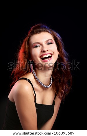 Young party girl isolated on black background - stock photo