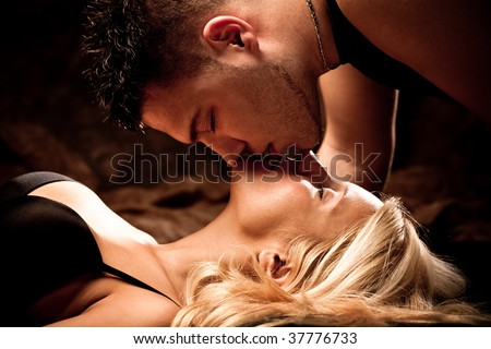 young passion lovers kissing, studio shot - stock photo