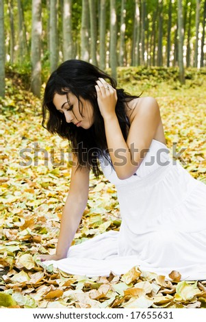 Young passional woman in a forest - stock photo